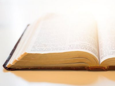 Open bible with white background